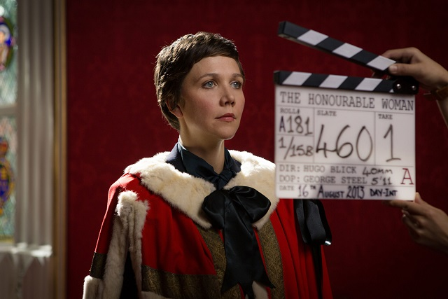 Behind the scenes filming image. Maggie Gyllenhaal dressed in her characters robes at the House of Lords – Image Credit: BBC/Drama Republic. Photographer: Robert Viglasky